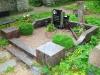 Poleeritud punakaspruunist graniidist hauapiire Siselinna kalmistul