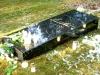 Lennart Meri haud Tallinna Metsakalmistul, mustast poleeritud graniidist hauakivi, kivist trepp ja pink - hauakivi