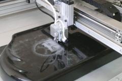 Masinaga portree graveerimine hauakivile